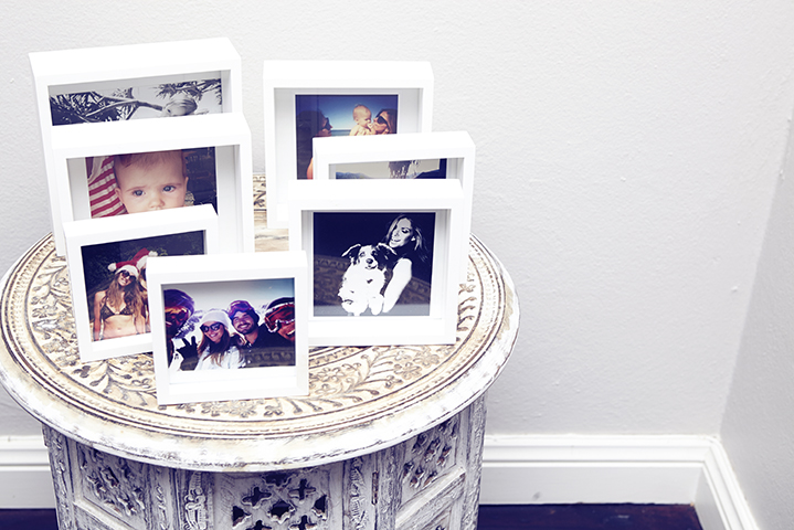 Photos of fond memories with family, friends and adventures decorate her home