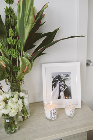 Diptyque  candles and wedding photos decorate her Port Melbourne home.