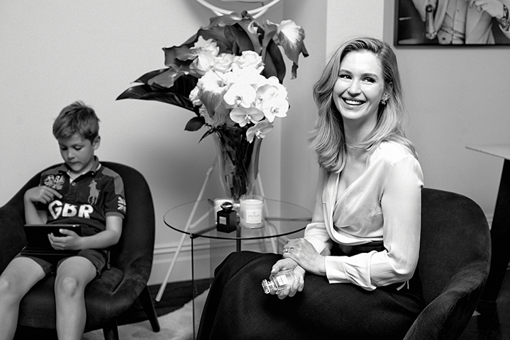 Melanie in her living room, with her son, Adam, 8