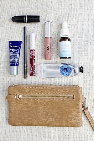 Night out essentials including lipstick, gloss and a good dose of eye cream