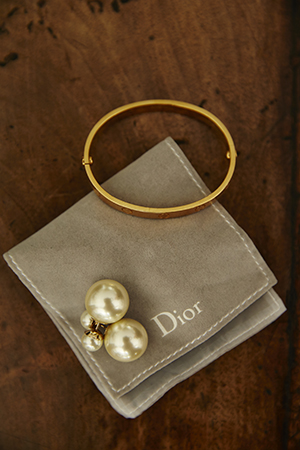 Her  Dior  earrings were a gift from her beau Sam Worthington