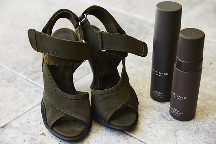 Her Prada sandals pair with her new tanning products perfectly