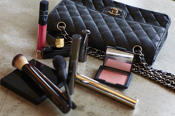 A classic Chanel purse overflowing with Nars, Chanel and By Terry