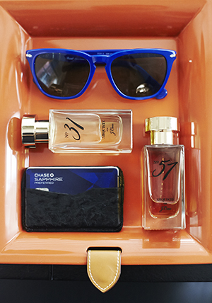 Cool cobalt sunnies compliment a couple of Arquiste fragrances