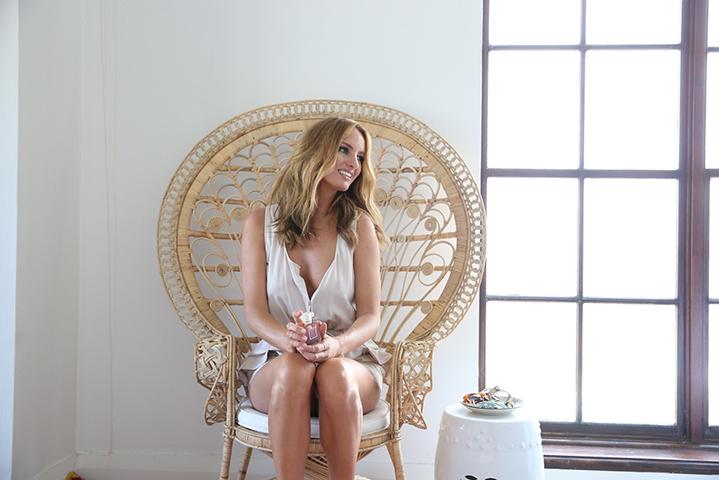 Samantha sits in a Matt Blatt peacock chair