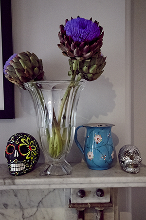 Beautiful blooms and decorative skulls adorn her mantlepiece