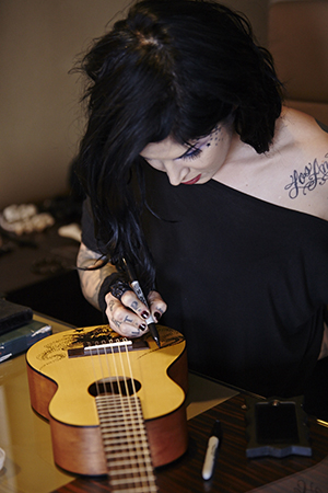 Guitars can have tattoos too...