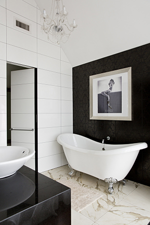 A vintage Barney's New York ad hangs above the bath.