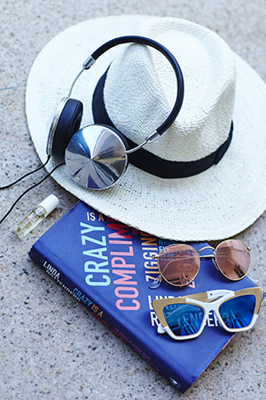A beach girl at heart; a good read, a dab of Kai perfume oil, a Uniqulo hat and uber cool sunnies complete the kit