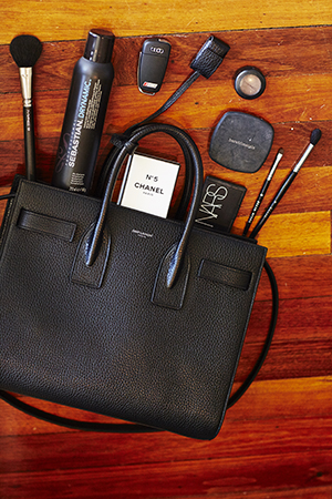Beauty essentials in Devin's bag of choice, Saint Laurent