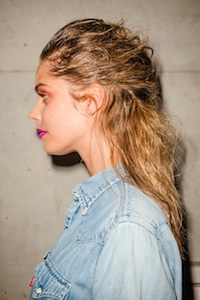 Un-done hair backstage at Jayson Brunsdon