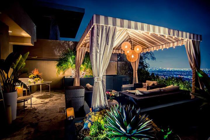 A cabana on the terrace views Hollywood's lights