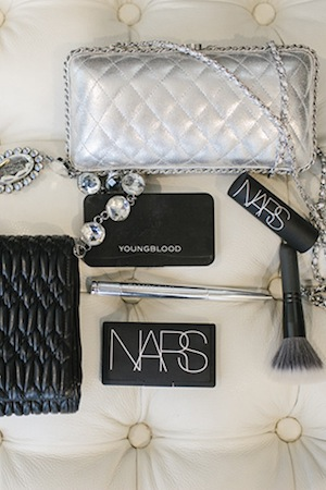 NARS, Ellis Faas and Youngblood are fixtures in her makeup bag. Pictured alongside her favourite Chanel and Miu Miu clutches.