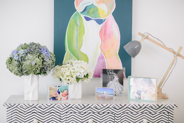 Photographs of the mum's most precious memories decorate a bone dresser