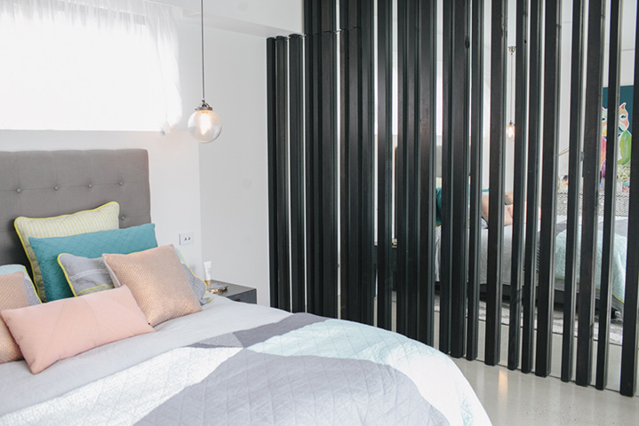 Modern architecture divides the bedroom from Bec's glamorous walk in wardrobe and dressing room