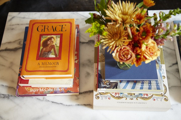 A collection of fashion-centric books and magazines on the marble coffee table