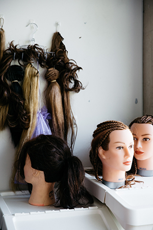 practise makes perfect; renya continues to practise different hair styles on mannequins