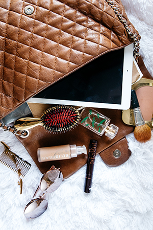 chanel show and tell; sunnies, ellis faas, hair brushes and her ipad are bag necessities