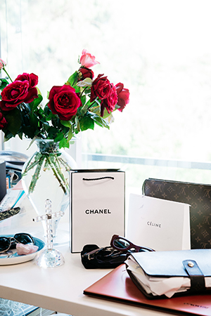 red roses fill renya's office, alongiside french favourites chanel, celine and louis vuiTTON