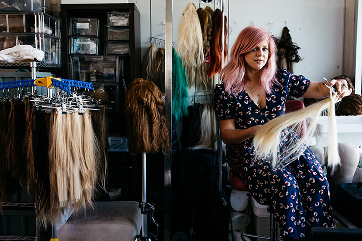 Renya's kind of relaxation; cutting, organising and playing with wigs in her workspace
