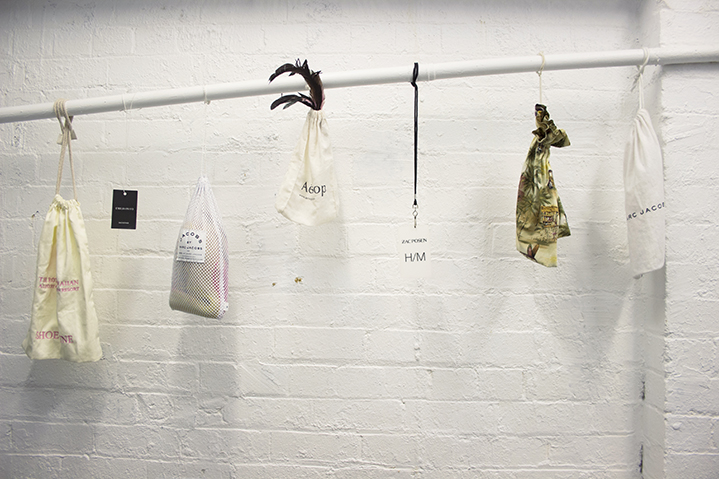 Office hangs; backstage passes for Fashion Week shows dangle amongst creatively-styled designer bags