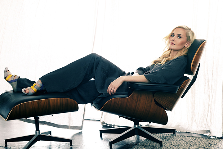 Anna gets comfy in her Eames chair, wearing a Ginger & Smart pant suit