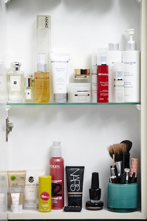 her cupboard is organised into skincare and makeup