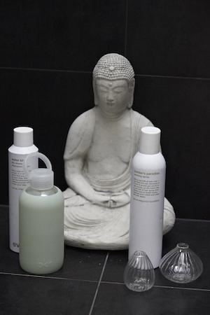a buddha in emma's bathroom adds an air of zen