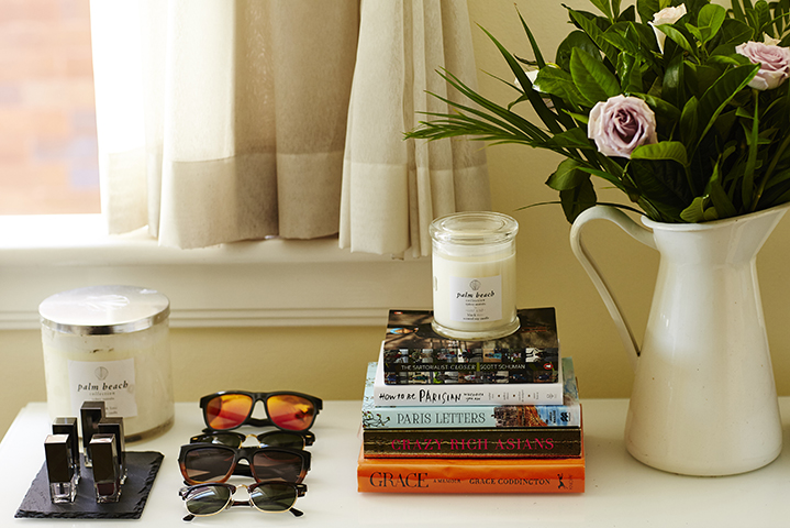 A cool collection of sunnies, Burberry nail polish and Palm Beach candles feature in Sally's abode