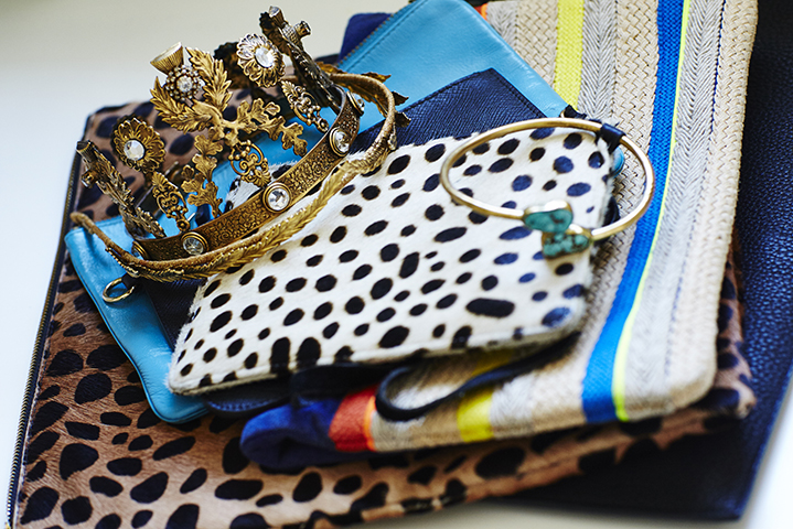 Assorted accoutrements including bejewelled crowns, turquoise and a splash of leopard