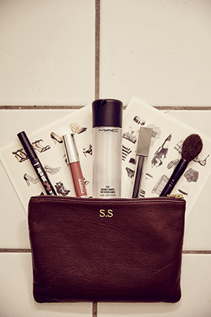 inside her beauty bag; benefit, mac, clinique and burberry