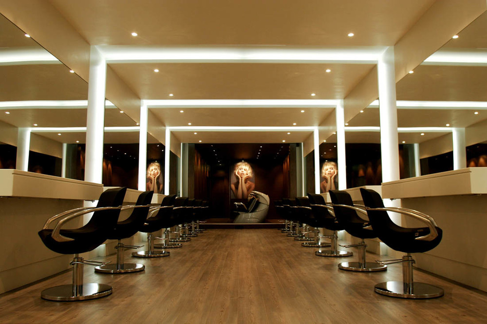 The mirrored walls enhance the size of the salon and add an element of glamour