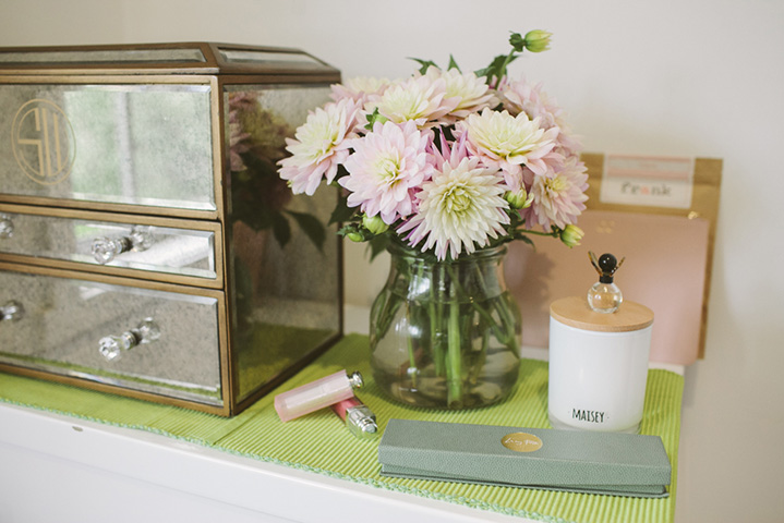 Dior lipgloss and blooms adorn her dressing table