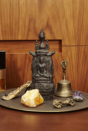 delta meditates with treasured items