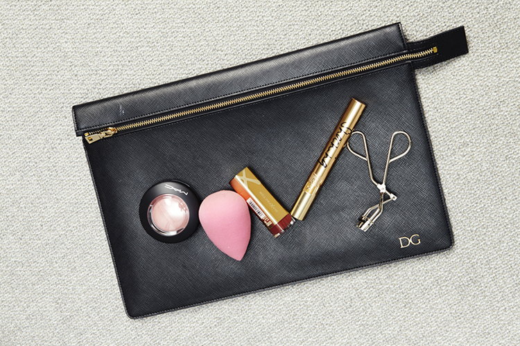 Delta's engraved pouch with her makeup must-haves: MAC, beauty blender and more
