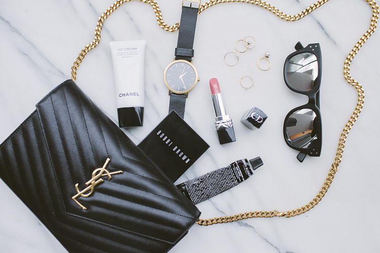 Fancy flat lay featuring French favourites YSL, Chanel and Christian Dior with gold dipped trimmings