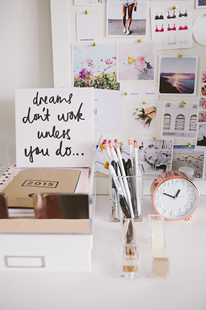 lisa's fun, kitsch workspace is peppered with rose gold accents and sun-filled snapshots
