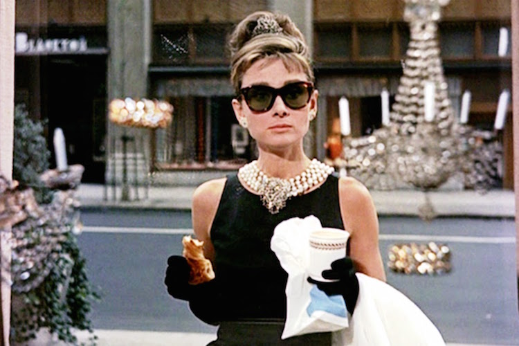Audrey eating her famous Breakfast At Tiffany's (1961)