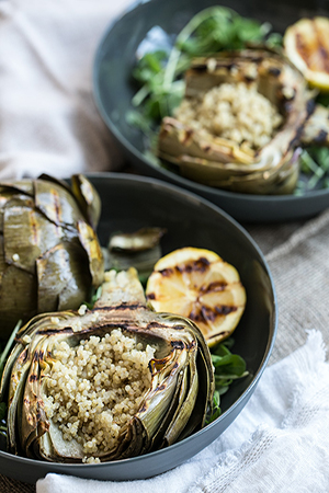 Do as the romans do with this heavenly recipe for  grilled artichokes marinated in garlic and lemon  by Jodi from What's Cooking Good Looking