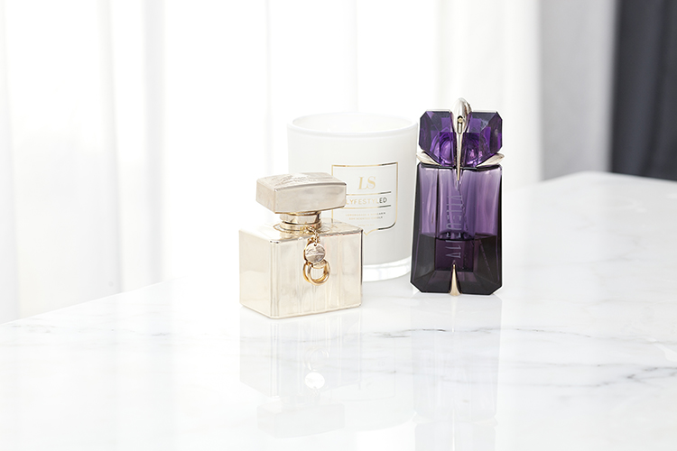 Kyly's favourite perfumes: Alien and Gucci along with her aromatic candles