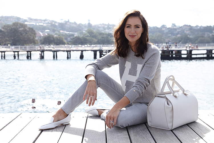 Sigourney wears Tommy Jumper sold out,  Citizens of Humanity jeans  and Victoria Beckham bag from  Belinda .