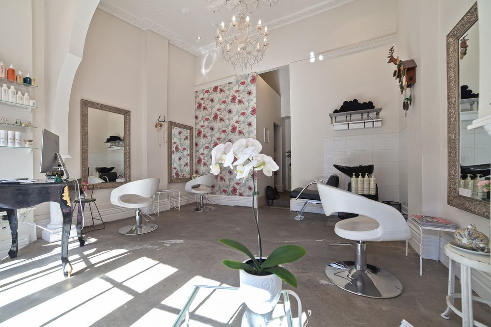 Owner, Deborah instantly fell in love with the polished cement floors and ornate ceiling
