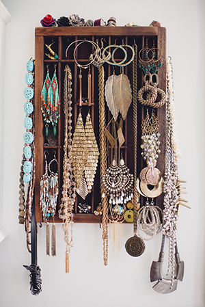 a repurposed antique printer drawer holds her ecclectic jewellery collection