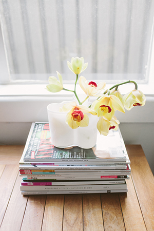 Happy yellow orchids sit atop piles of inspiration