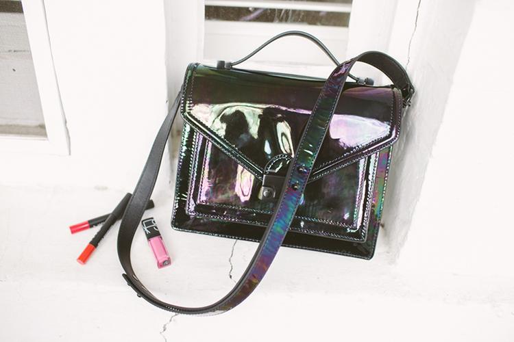 Bridge's iridescent, patent petrol bag by Loeffler Randall and her favourite Nars lipsticks
