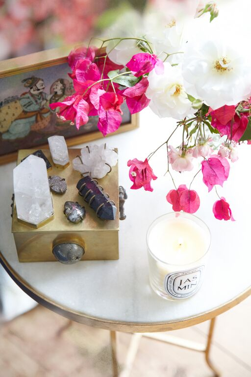 Healing crystals, pretty blooms and a sweetly scented 'Jasmin' candle by Diptyque take pride of place