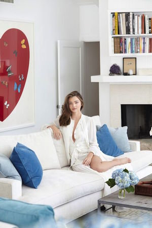 Her custom-made velvet sofa is by Michael Jon Designs