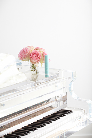 A custom-made transparent grand piano sits in the living room paying tribute to Miranda's grandmother who taught her to play at a young age.