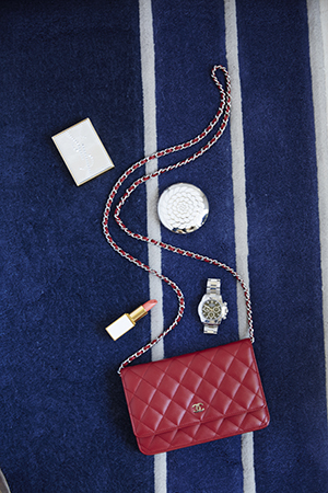 A quilted red Chanel hand bag is part of Roxy's enviable designer collection