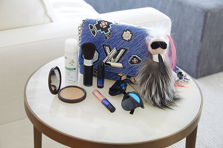 Roxy's beauty essentials, Louis Vuitton and Karl keyring